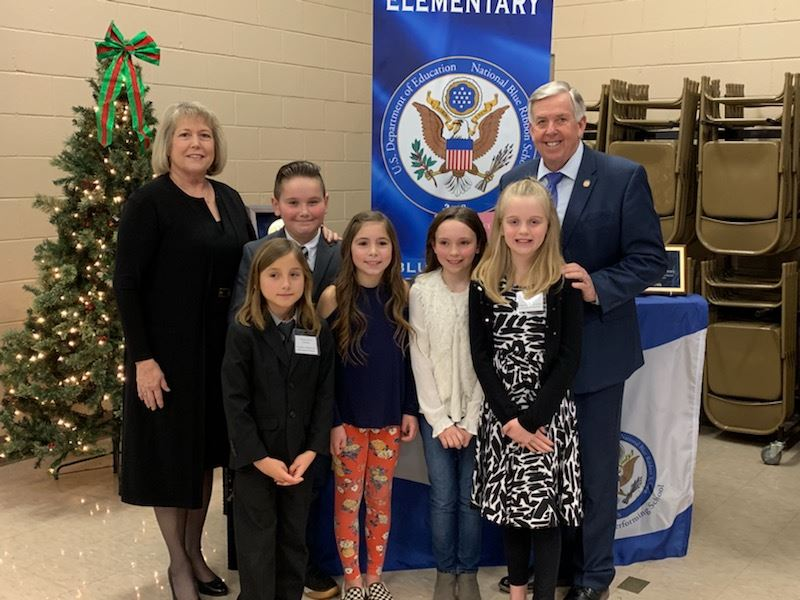 Governor Parson and First Lady Teresa Parson with students
