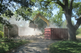 Demolition of stone house