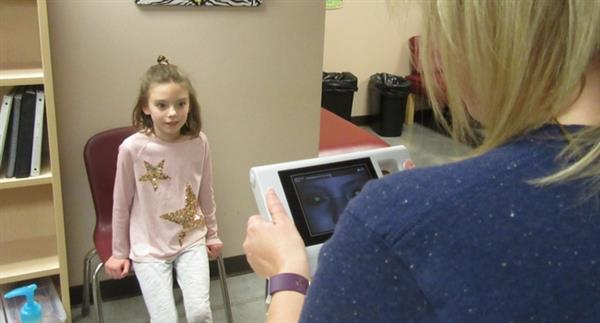 WOHE Student gets vision tested with new vision screener tool